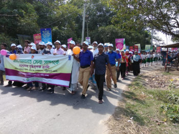 Union Parishad members and community people participated in a rally for raising mass awareness on village courts' services at union level