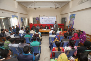Participants of a community sharing meeting at union level express their interest and commitments to make village courts functional with their active involvement at various levels