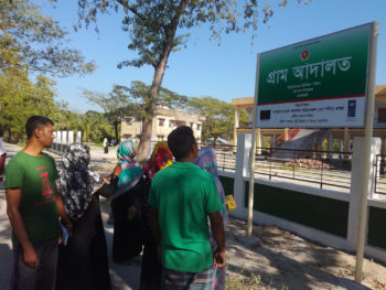 A signboard of village court at the union parishad premise attracts service seekers of the community to learn more about its services