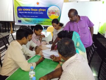 Group work session of UP representatives at the training on village courts